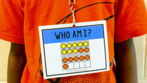 boy wearing addition math tags with ten frames